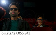 Купить «Couple in 3d glasses watching movie in theatre 4k», видеоролик № 27055843, снято 17 сентября 2019 г. (c) Wavebreak Media / Фотобанк Лори