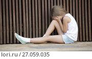 Купить «portrait of sad girl being alone and worried outdoors», видеоролик № 27059035, снято 7 сентября 2016 г. (c) Яков Филимонов / Фотобанк Лори