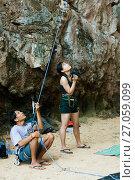 Купить «Мужчина страхует скалолаза страховочной веревкой, а женщина фотографирует», фото № 27059099, снято 15 декабря 2010 г. (c) Эдуард Паравян / Фотобанк Лори