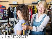 Купить «Tailor measuring customer in atelier», фото № 27060727, снято 19 августа 2019 г. (c) Яков Филимонов / Фотобанк Лори