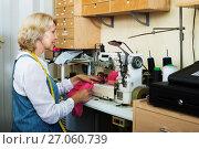 Купить «Tailor using sewing machine», фото № 27060739, снято 22 февраля 2020 г. (c) Яков Филимонов / Фотобанк Лори