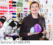 Купить «Woman holding shopping bags and accessories for knitting and embroidery», фото № 27060979, снято 10 мая 2017 г. (c) Яков Филимонов / Фотобанк Лори