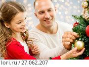 Купить «father and daughter decorating christmas tree», фото № 27062207, снято 14 сентября 2014 г. (c) Syda Productions / Фотобанк Лори