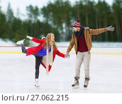 Купить «happy couple holding hands on skating rink», фото № 27062215, снято 26 ноября 2014 г. (c) Syda Productions / Фотобанк Лори