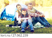 Купить «happy family with tablet pc and tent at camp site», фото № 27062239, снято 27 сентября 2015 г. (c) Syda Productions / Фотобанк Лори