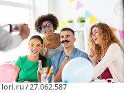 Купить «friends or team photographing at office party», фото № 27062587, снято 3 сентября 2017 г. (c) Syda Productions / Фотобанк Лори