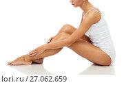 Купить «beautiful woman touching her smooth bare legs», фото № 27062659, снято 9 апреля 2017 г. (c) Syda Productions / Фотобанк Лори