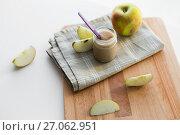 Купить «jar with apple fruit puree or baby food on table», фото № 27062951, снято 21 февраля 2017 г. (c) Syda Productions / Фотобанк Лори