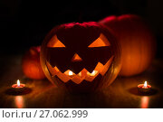 Купить «halloween jack-o-lantern burning in darkness», фото № 27062999, снято 15 сентября 2017 г. (c) Syda Productions / Фотобанк Лори