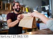 Купить «man or bartender serving customer at coffee shop», фото № 27063131, снято 8 декабря 2016 г. (c) Syda Productions / Фотобанк Лори