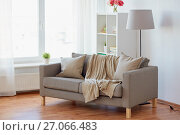 Купить «sofa with cushions at cozy home living room», фото № 27066483, снято 19 мая 2017 г. (c) Syda Productions / Фотобанк Лори