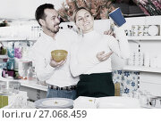 Купить «Couple selecting crockery in store», фото № 27068459, снято 8 февраля 2017 г. (c) Яков Филимонов / Фотобанк Лори
