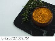 Купить «Rosemary with turmeric powder in bowl», фото № 27069751, снято 5 июня 2017 г. (c) Wavebreak Media / Фотобанк Лори