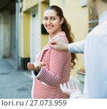 Купить «man chasing pleased woman and flirting», фото № 27073959, снято 15 декабря 2017 г. (c) Яков Филимонов / Фотобанк Лори