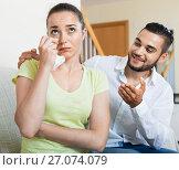 Купить «Young man talking to upset woman», фото № 27074079, снято 17 октября 2018 г. (c) Яков Филимонов / Фотобанк Лори