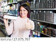 Купить «Female choosing hair dye», фото № 27075767, снято 17 августа 2018 г. (c) Яков Филимонов / Фотобанк Лори