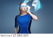 woman in virtual reality 3d glasses with earth. Стоковое фото, фотограф Syda Productions / Фотобанк Лори