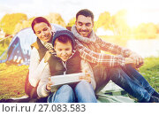 Купить «happy family with tablet pc and tent at camp site», фото № 27083583, снято 27 сентября 2015 г. (c) Syda Productions / Фотобанк Лори