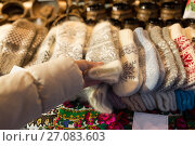 Купить «woman buying woolen mittens at christmas market», фото № 27083603, снято 1 декабря 2016 г. (c) Syda Productions / Фотобанк Лори