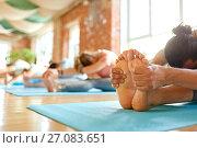 Купить «group of people doing yoga forward bend at studio», фото № 27083651, снято 5 марта 2017 г. (c) Syda Productions / Фотобанк Лори