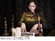 Купить «Young woman with divination cards in room», фото № 27092175, снято 5 марта 2017 г. (c) Майя Крученкова / Фотобанк Лори