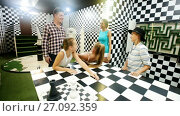 Купить «Young family is satisfied of visit of entertainment styling chessroom.», видеоролик № 27092359, снято 11 августа 2017 г. (c) Яков Филимонов / Фотобанк Лори