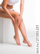Купить «Woman touching legs», фото № 27093231, снято 29 мая 2017 г. (c) Иван Михайлов / Фотобанк Лори