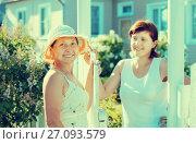 Купить «women near fence wicket», фото № 27093579, снято 5 июня 2011 г. (c) Яков Филимонов / Фотобанк Лори