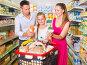 Smiling family of three in the supermarket, фото № 27093875, снято 11 июля 2017 г. (c) Яков Филимонов / Фотобанк Лори