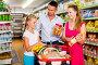 family of three choosing food in the grocery shop, фото № 27093879, снято 11 июля 2017 г. (c) Яков Филимонов / Фотобанк Лори