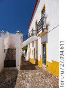Купить «Cozy narrow paved streets with white houses inside the old city walls of Mertola. Beja. Portugal», фото № 27094611, снято 30 июня 2016 г. (c) Serg Zastavkin / Фотобанк Лори