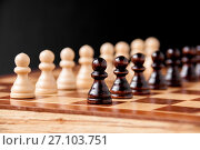 Купить «Still life on the chessboard: white and black pawns stand in a row», фото № 27103751, снято 5 октября 2017 г. (c) Катерина Белякина / Фотобанк Лори