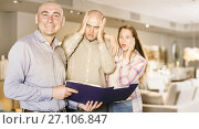 Купить «Furniture salesman with couple shocked by prices», фото № 27106847, снято 16 мая 2017 г. (c) Яков Филимонов / Фотобанк Лори