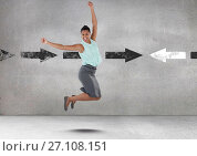 Businesswoman jumping with celebration and joy by arrows in opposite directions. Стоковое фото, агентство Wavebreak Media / Фотобанк Лори