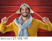 Купить «Man against wood with warm hat and scarf», фото № 27108191, снято 26 апреля 2018 г. (c) Wavebreak Media / Фотобанк Лори