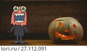 Купить «Monster cartoon standing next to halloween pumpkin», фото № 27112091, снято 17 июня 2019 г. (c) Wavebreak Media / Фотобанк Лори
