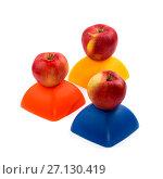 Купить «Три спелых красных яблока на жёлтой, красной и синей фигуре», фото № 27130419, снято 20 октября 2017 г. (c) V.Ivantsov / Фотобанк Лори