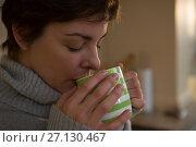 Купить «Woman drinking coffee in kitchen», фото № 27130467, снято 10 августа 2017 г. (c) Wavebreak Media / Фотобанк Лори