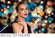 Купить «woman with credit card and shopping bags», фото № 27133479, снято 14 апреля 2016 г. (c) Syda Productions / Фотобанк Лори
