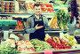 young man seller showing assortment of grocery shop, фото № 27133523, снято 18 марта 2017 г. (c) Яков Филимонов / Фотобанк Лори