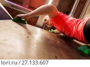 Купить «young woman exercising at indoor climbing gym», фото № 27133607, снято 2 марта 2017 г. (c) Syda Productions / Фотобанк Лори