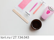 Купить «hair removal wax, epilator and safety razor», фото № 27134043, снято 12 апреля 2017 г. (c) Syda Productions / Фотобанк Лори