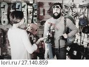 Купить «Couple deciding on climbing equipment», фото № 27140859, снято 24 февраля 2017 г. (c) Яков Филимонов / Фотобанк Лори