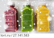 Купить «bottles with different fruit or vegetable juices», фото № 27141583, снято 5 августа 2016 г. (c) Syda Productions / Фотобанк Лори