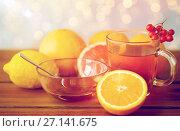 Купить «tea with honey, lemon and rowanberry on wood», фото № 27141675, снято 13 октября 2016 г. (c) Syda Productions / Фотобанк Лори