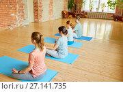 Купить «group of people making yoga exercises at studio», фото № 27141735, снято 5 марта 2017 г. (c) Syda Productions / Фотобанк Лори