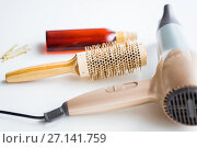Купить «hairdryer, brush, hot styling hair spray and pins», фото № 27141759, снято 12 апреля 2017 г. (c) Syda Productions / Фотобанк Лори
