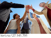 Купить «group of happy people making high five in city», фото № 27141791, снято 13 мая 2017 г. (c) Syda Productions / Фотобанк Лори