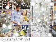 Купить «couple with shopping cart buying food at grocery», фото № 27141891, снято 21 октября 2016 г. (c) Syda Productions / Фотобанк Лори