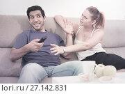 Купить «Couple arguing because of TV remote», фото № 27142831, снято 22 марта 2019 г. (c) Яков Филимонов / Фотобанк Лори